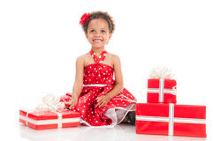Little beautiful mulatto girl with gifts Stock Images