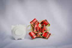 Little beautiful piggy bank and gift box on white background , v Stock Photos