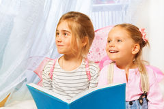 Little beautiful pixies reading the fairy-tale Royalty Free Stock Image