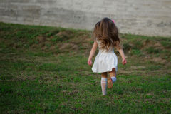 Little beautiful running girl outside Royalty Free Stock Image