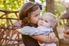Little beautiful sisters in autumn park Royalty Free Stock Images