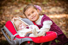 Little beautiful sisters in park Royalty Free Stock Photo