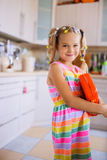 Little beautiful smiling girl holding toy bag Stock Image
