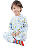 A little beautirul kid in pajamas Stock Photos