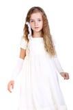 Little beauty. Beautiful little girl in the white festive dress Stock Photo