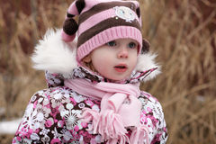 Little beauty girl slightly frozen. With pink nose dismount to home royalty free stock images