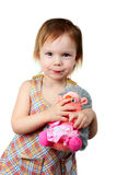 Little beauty girl with toy hedgehog. Little beauty girl keep silence purse her's lips with toy hedgehog to hand which keep silence too royalty free stock photography