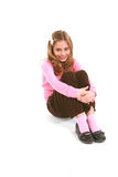 Little beauty hugging knees Stock Images