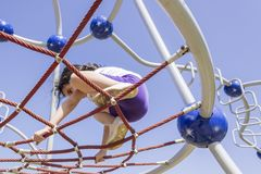 Little beginner school girl playing at playground royalty free stock photo