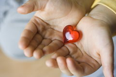 Little big heart of young child Stock Images