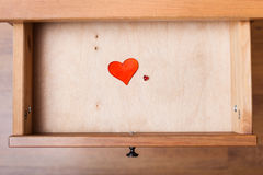 Little and big red hearts in open drawer Stock Images