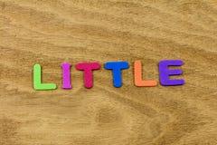 Little big small bigger size learning children foam toy. Education preschool spelling school plastic letters words spelling toddler development school stock image