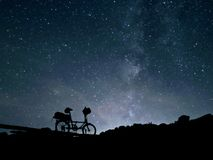 Little bike big sky. Small folding type bicycle for bike touring with star filled sky at night at mountains of northern New Mexico Royalty Free Stock Photography