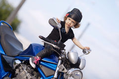 Little biker on road with motorcycle Royalty Free Stock Photography