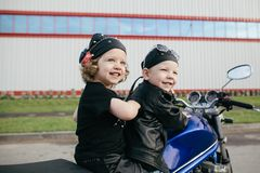 Little bikers on road with motorcycle Stock Image