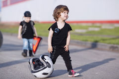 Little bikers on road with motorcycle Royalty Free Stock Photography