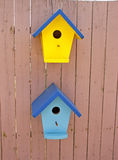 Little Bird Houses. Little ornamental birdhouses attached to a fence stock images