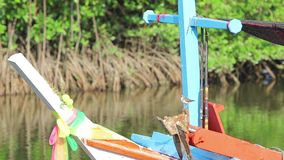 Little bird on the boat. Little bird sits on a river boat stock footage