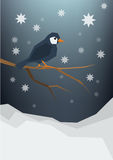 A little bird sitting on a bare brunch, snowfall, night sky. Winter holidays postcard, greeting card,  background. A little bird sitting on a bare brunch Royalty Free Stock Image