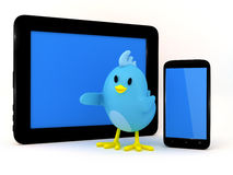 Little bird with smartphone and tablet Stock Photography