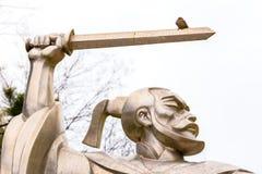 Little bird on a warriors sword Stock Image