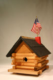 Little birdcabin. Birdhouse with american flag on top stock image