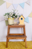 Little birdhouse. Easter decorations. Wooden nestbox on a little table stock photos