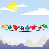 Little birds perched on the wire Stock Photography