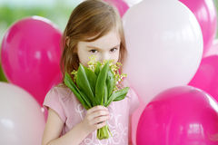 Little birthday girl with pink balloons Royalty Free Stock Image