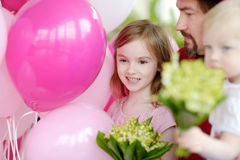 Little birthday girl with pink balloons. And flowers Stock Photos
