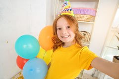 Little birthday girl taking photo of herself Royalty Free Stock Photography