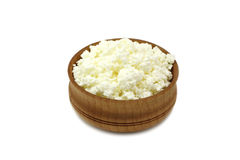 A little bit of cheese in a wooden bowl Royalty Free Stock Image
