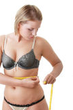 A little bit fat young woman mesuring her body Stock Images