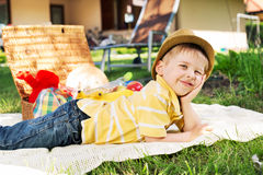 Little bit tired boy resting on the blanket Royalty Free Stock Photography