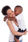 Little black boy kissing her mother Royalty Free Stock Image