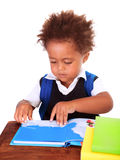 Little black boy reading books Royalty Free Stock Photo
