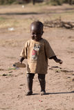 Little black boy standing in dirt compound Stock Photography