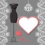 Little black dress with chandelier,label,paisley border Stock Image