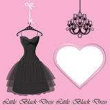 Little black dress with label and chandelier Stock Photos