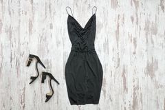 Little black dress and shoes. Wooden background, fashionable con. Cept royalty free stock photography