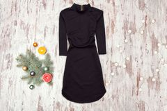 Little black dress with sleeves and spruce branch royalty free stock images