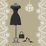 Little black dresses with chandelier and paisley border Royalty Free Stock Photos