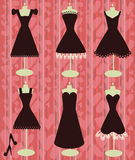 Little black dresses on the heart shapes backgroun Royalty Free Stock Image