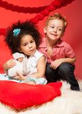Little black girl and Caucasian boy. Little black curly dark girl and Caucasian blond boy hugging Stock Photos
