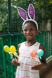 Little black girl celebrating easter. Little black girl celebrating easter Royalty Free Stock Photos