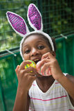 Little black girl celebrating easter. Stock Photo