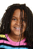 Little black girl with hair over face. Closeup of little black girl with hair over face Royalty Free Stock Image