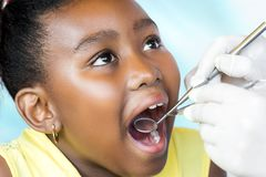 Little black girl having dental checkup. Royalty Free Stock Image