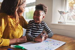 Little black girl learning to calculate. For elementary school Royalty Free Stock Images