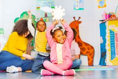 Little black girl show sunny weather card in class royalty free stock image